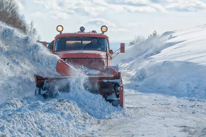a commerical vehicle clearing snow
