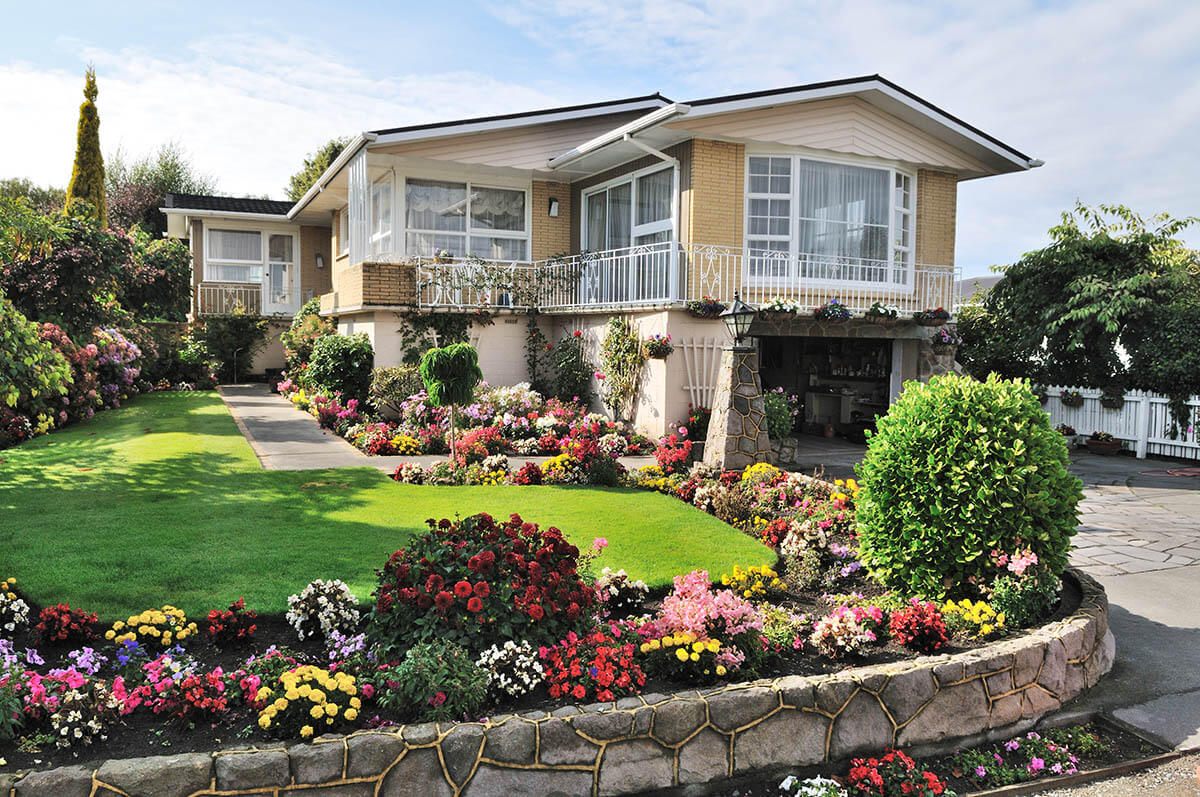 a home with landscaped flower beds