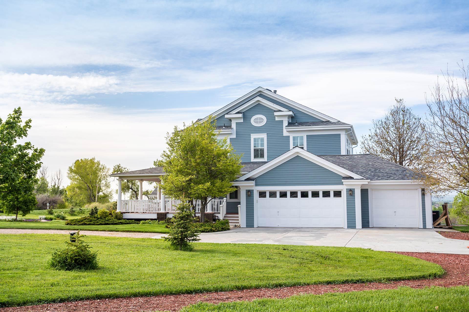 a blue 2-story home