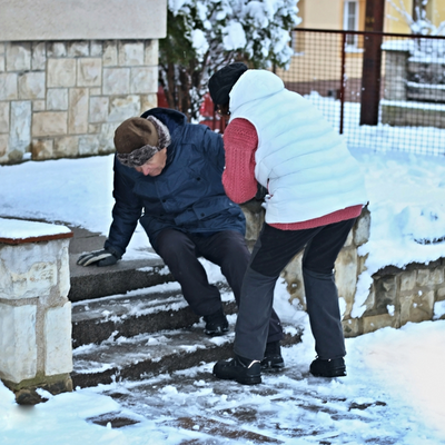 man slipping on icy steps